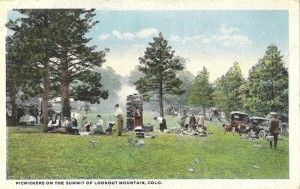 Picnickers on the Summit of Lookout Mountain, Denver Mountain Parks. Near Colonel Cody's grave and Pahaska Tepee, is the Lookout Mountain Shelter House, surrounded by a half-dozen open air stone ovens, built by the City of Denver for the convenience of her citizens and visitors who wish to picnic under the pine trees.  Several thousand automobiles have been accommodated in Lookout Mountain park on one day, and this is only one of eighteen parks in the Denver Mountain Park system.
