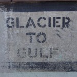 Glacier to Gulf sign on the side of a building in Montana