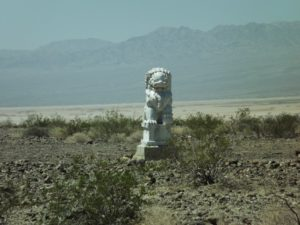 mystery statue in the middle of the desert