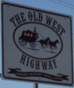 old west highway sign