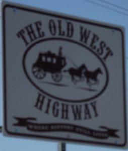 old west highway sign