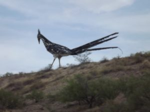 giant bird by the side of the road
